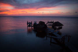 Sunset on the dock in front of Turtle Casa, Roatan Sandy Bay