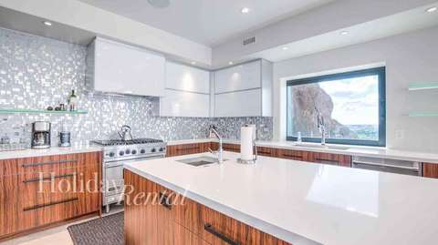 Huge brand new kitchen with city and mountain views