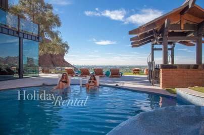 Relax in this custom pool with city views