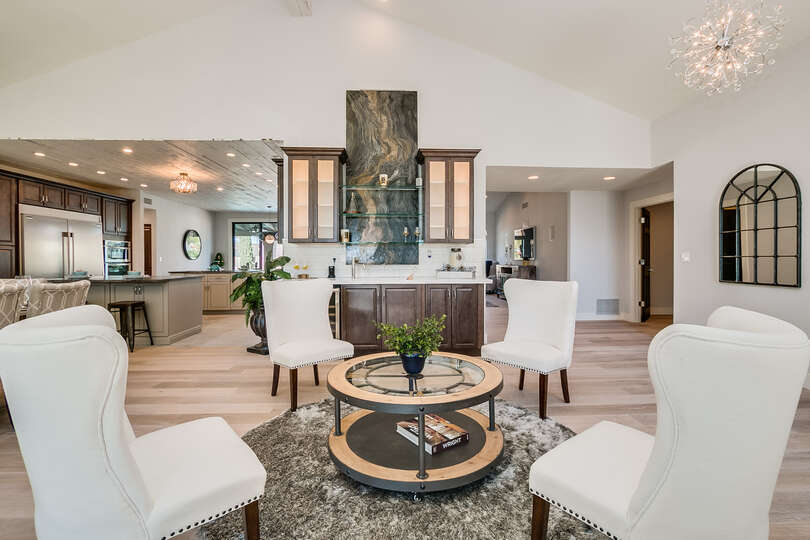 Sitting area with a waterfall wet bar