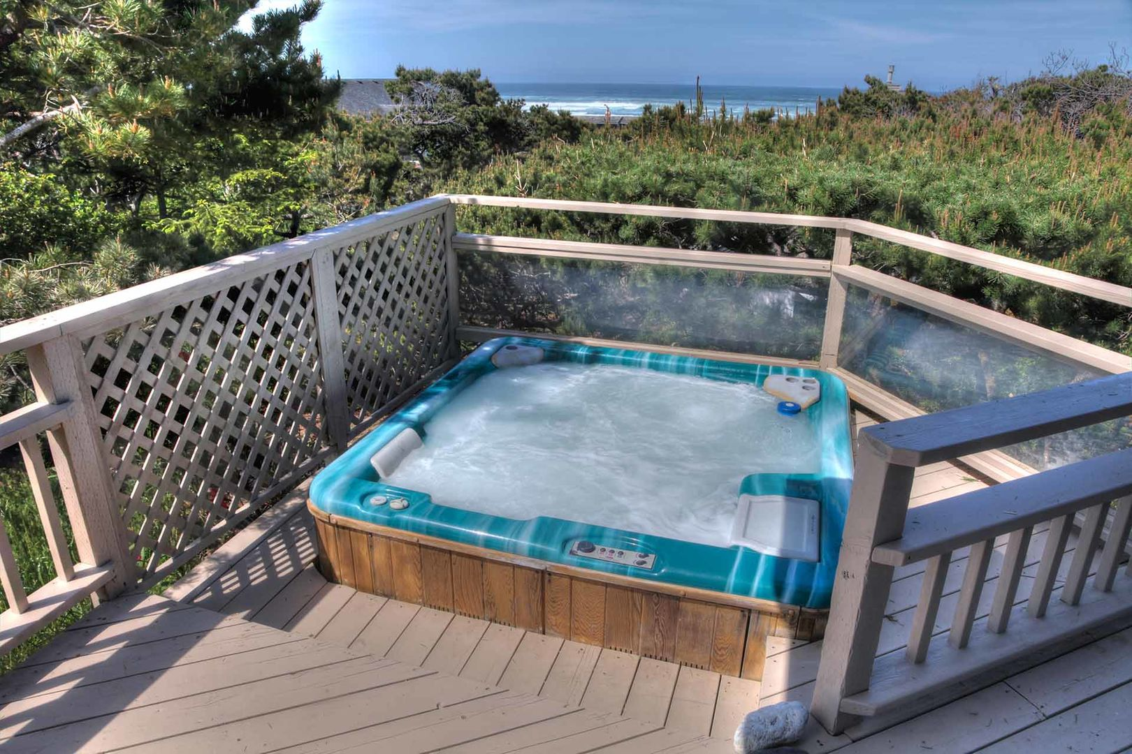 Sunken hot tub, relax to the sounds of the Sea, nestled in the pines.