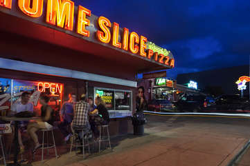 Nearly world famous Home Slice Pizza will satisfy your craving for pie.