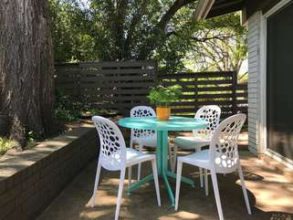 Relax on the back patio. The gold door has a fully fenced yard, and gas bbq.