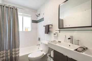 The bathroom features The bathroom features a bathtub/shower and beautiful designer fixtures.