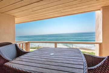 The table and chair set on the oceanfront deck at your condo!