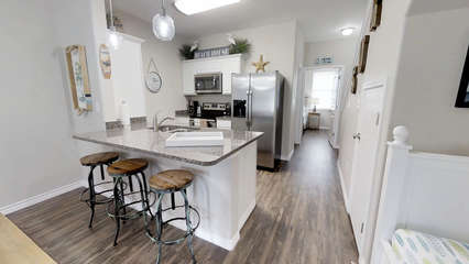 Kitchen with large island and stainless appliances