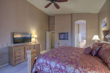 Master suite has large television for binge watching your favorite shows after exciting days of outdoor fun