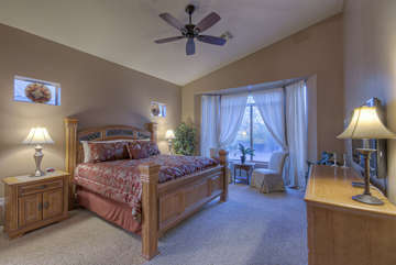 Who wouldn't want to be tucked into this deluxe king bed in elegant master suite!