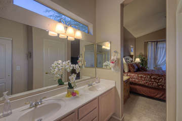 With dual vanity sinks in master bath, two can get ready at the same time for a golf or dinner date