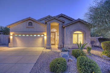 Pretty home with professionally landscaped yard and 2 car garage is situated in lovely, quiet neighborhood