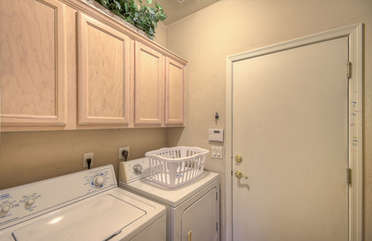 Separate well stocked laundry room has family size appliances so clothing is always ready for the next adventure