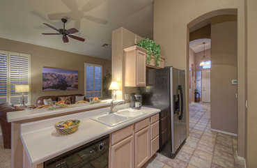 Granite counters, vaulted ceilings and arched doorways are endearing qualities that add to home's appealing ambiance