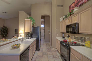 Kitchen opens into family room for ease in serving snacks and meals. Bar seating is perfect for a delicious margarita or meals on the run.