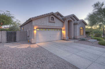 Home has enclosed yard for peaceful moments in the warm Arizona sun or to keep small children safe