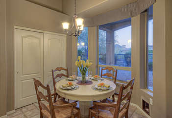 Charming dining area has windows for viewing birds and other wildlife attracted to open natural areas