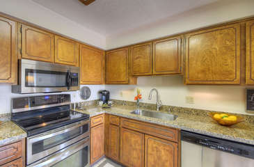 Kitchen upgrades include newly refinished kitchen cabinets and granite counters