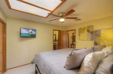 Second bedroom with large skylight has king bed, TV and private access to second bathroom