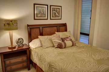 Beautifully furnished bedroom with queen bed