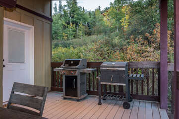 Both propane and charcoal grills on the covered deck