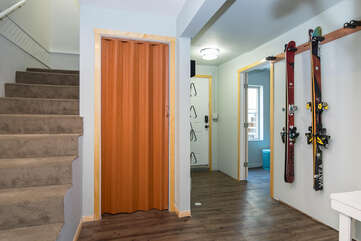 Entry way with ski storage, boot dryers and gear closet
