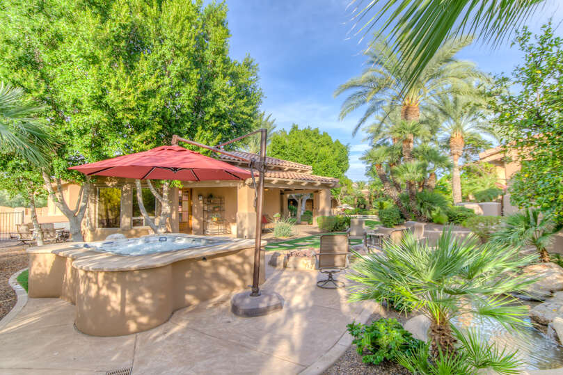Step up into the shaded hot tub!