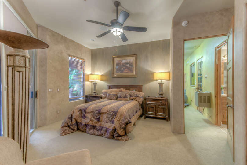 Located across the courtyard is the private guest home and secluded bedroom.