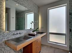 Master bathroom with two sinks, shower, and...