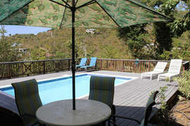Large pool deck with lounge area and alfresco dining