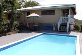 Pool deck up to the covered patio and main house
