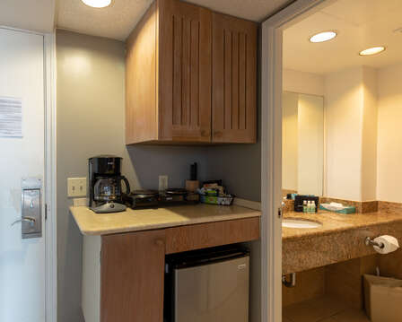Small fridge with coffee maker and counter space