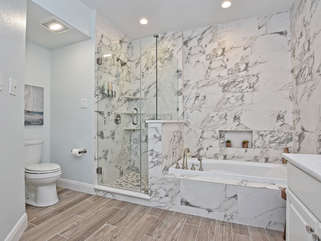 GORGEOUS master bath with marble tile surrounding. An amazing way to wind down.