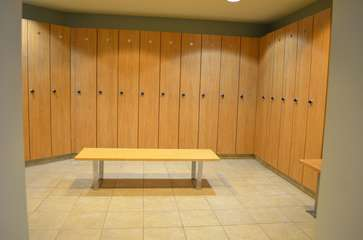 Locker rooms with saunas, indoor pool and workout facility
