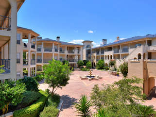 One of the many beautiful courtyards of The Island on Lake Travis!