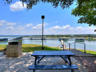 Charcoal BBQ and picnic area overlooking the lake! Perfect place to fish, too!