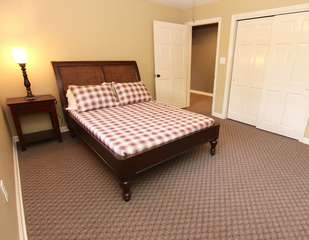 Bedroom with full bed, single bed & TV-lower level
