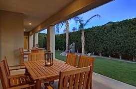 Twilight dinning area in backyard