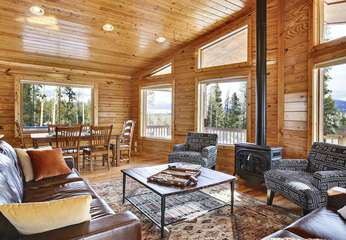 Another View of the spacious Living room, the seating area here is where you will find yourself relaxing most often, views of protected land on 3 sides.