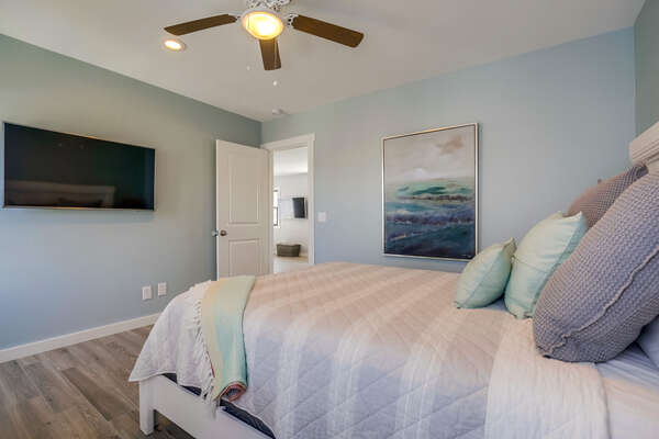 Master bedroom with Queen bed, flat screen TV, ceiling fan