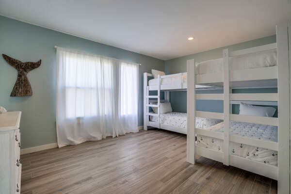 2nd bedroom with four twin beds. Great for kids!