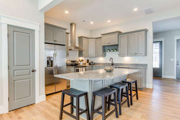 Kitchen with Large Island and Stools