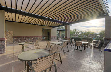 Community clubhouse offers shaded meeting areas for meals, games and conversations