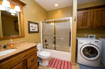 Downstairs shared bathroom with 2nd set of washer & dryer
