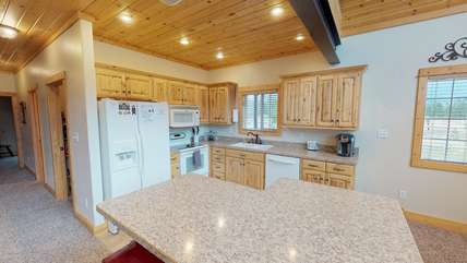 This kitchen has everything you will need to make a yummy dinner.
