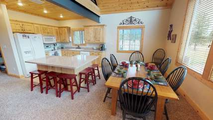 The kitchen provides lots of seating for your family to enjoy a meal around the table.