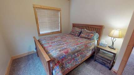 One of the bedrooms on the main level of the home.