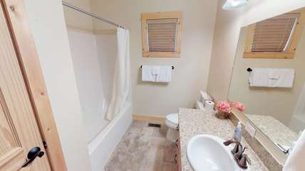 This clean, quaint bathroom is located on the main floor also.
