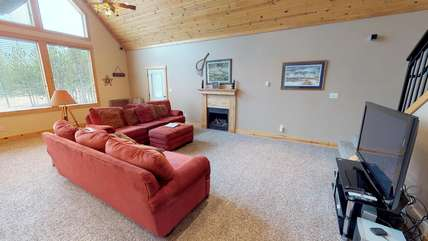 With a T.V. and fireplace this living room is one of the coziest places in the house.