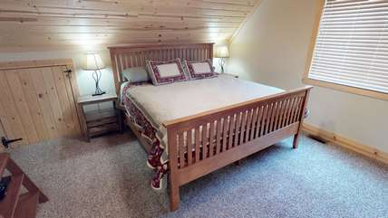 The master bedroom is located upstairs and offers plenty of room to relax.
