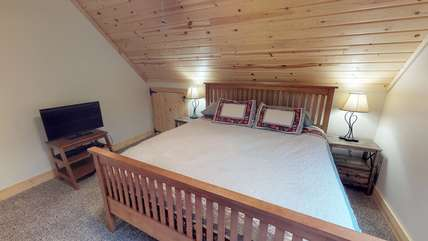 Another view of the master bedroom which also includes a T.V.
