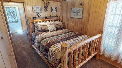 The cozy cabin also has a comfy queen bed to get a good nights rest.